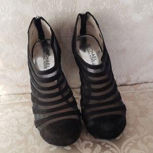 Michael Kors leather and mesh shoe.
